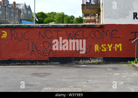 Dissident republican graffiti, saying police are not welcome, on a wall in the Bogside in Derry, Northern Ireland.  ©George Sweeney / Alamy Stock Photo - Stock Photo