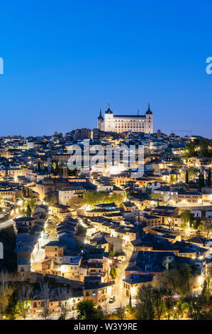 The Old Town of Toledo and the Alcazar at twilight, a Unesco World Heritage Site. Castilla la Mancha, Spain - Stock Photo