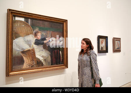 London, UK. 17th July, 2019. A staff member looks onto the Helene Schjerfbeck's painting ''The Convalescent (1888)'' at the Royal Academy of Arts during the preview of her first ever exhibition in London.The exhibition features around 65 portraits, landscapes and still life, charting the development of Helene Schjerfbeck's work from a naturalistic style inspired by French Salon painters in the early 1880s, to a radically abstracted and modern approach from the turn of the twentieth century onwards. The exhibition runs from 20 July to 27 October 2019. (Credit Image: © Dinendra Ha - Stock Photo
