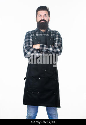 Being lost in serious thought. Bearded man with serious look wearing work apron. Hipster with long beard and mustache on serious face. Serious man keeping arms crossed. - Stock Photo