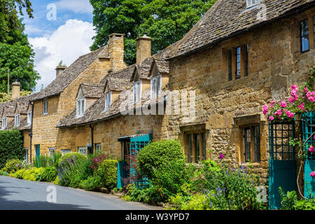 Stone cottages in the village of Snowshill in the Cotswolds, England - Stock Photo