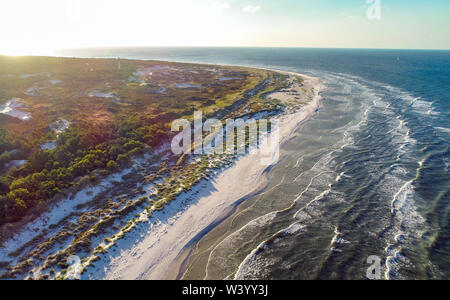 Dueodde, Denmark. 01st July, 2019. The coast with the wide beach and the adjoining forest at the southeast tip of the Danish Baltic Sea island (aerial view with a drone). This beach in Dueodde is one of the most beautiful in Denmark. The island Bornholm is, together with the offshore archipelago Ertholmene, Denmark's most eastern island. Thanks to its location, the island of Bornholm counts many hours of sunshine. Credit: Patrick Pleul/dpa-Zentralbild/ZB/dpa/Alamy Live News - Stock Photo