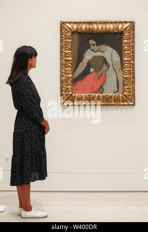 A staff member looks onto the Helene Schjerfbeck's painting 'Alarm 1935' at the Royal Academy of Arts during the preview of her first ever exhibition in London.The exhibition features around 65 portraits, landscapes and still life, charting the development of Helene Schjerfbeck's work from a naturalistic style inspired by French Salon painters in the early 1880s, to a radically abstracted and modern approach from the turn of the twentieth century onwards. The exhibition runs from 20 July to 27 October 2019. - Stock Photo