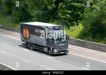 Booths supermarket Mercedes Benz; Heavy bulk haulage delivery trucks, lorry, transportation, truck, cargo, vehicle, delivery, transport, industry logistics, freight, on the M6 at Lancaster, UK