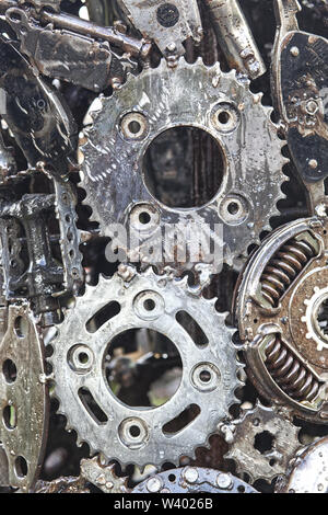 Car parts fused together to make a steel pattern - Stock Photo