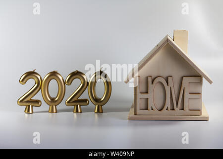 2020 year of candles and a homemade wooden house. Illustration for postcards and new year. - Stock Photo