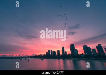 Blue hour lights up the sky over the Nerang River, Queensland. - Stock Photo