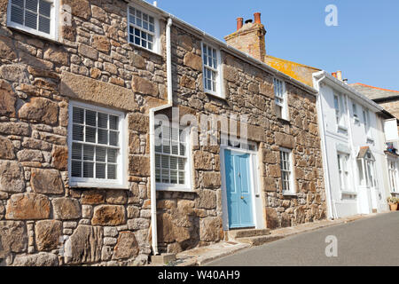 Narrow street with traditional stone houses in a coastal town of St Ives, Cornwall, United - Stock Photo