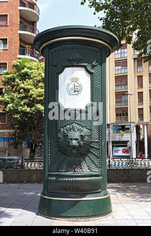 green iron drinking water fountain with lion head in downtown bilbao spain - Stock Photo