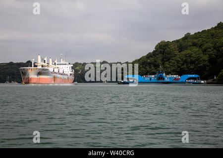 The SSI Reliance Cargo bulk carrier, and the King Harry Chain ferry in the Fal River estuary, Cornwall, England. - Stock Photo