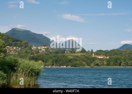 Beautiful lakeside view on the village of Muzzano, Mount Monte Boglia and Mount Monte Bre in the Lugano region in the Canton of Ticino, Switzerland - Stock Photo
