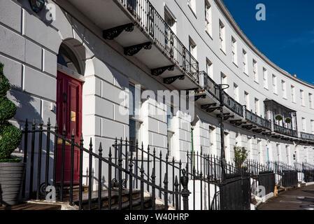 Elegant Regency buildings on the Royal Crescent, Cheltenham, UK - Stock Photo