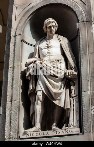 FLORENCE, ITALY - APRIL, 2018: Statue of Niccola Pisano at the courtyard of the Uffizi Gallery in Florence - Stock Photo