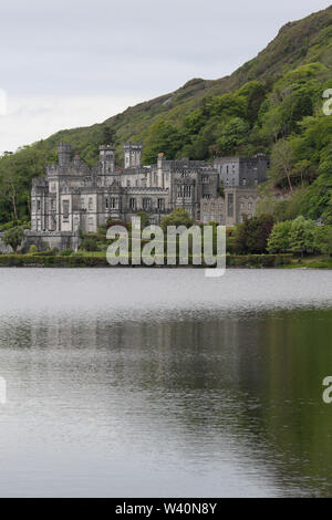 Benedictine abbey in Ireland at Kylemore Abbey, Connemara,County Galway, the former granite faced castle viewed across Pollacapall Lough in spring. - Stock Photo