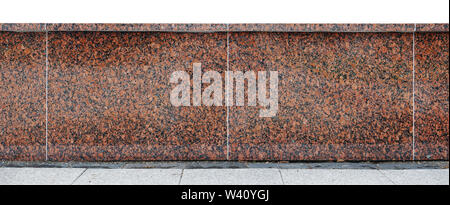 Wall from big red granite polished blocks are connected together by concrete. Isolated on top - Stock Photo