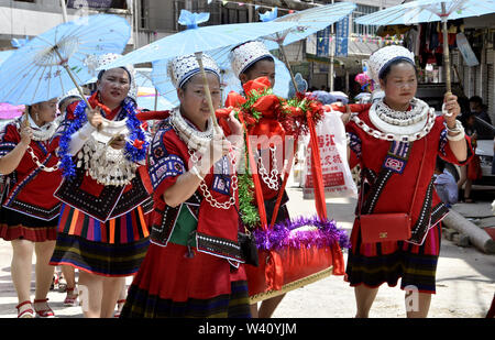 Guizhou, China. 19th July, 2019. The people of kitang village, kitang town, kaili city, guizhou province welcomed the traditional Miao festival ''eating new festival''.Nearly 1,000 Miao people from surrounding villages gathered together in their full costumes to celebrate the festival by singing Miaosongs and parading in costumes.The ''eating new festival'' is a festival where local Miao people wish a good harvest of rice, and it is also a festival where unmarried young men and women of the miao ethnic group are looking for their love. Credit: ZUMA Press, Inc./Alamy Live News - Stock Photo