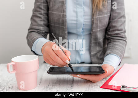 Business concept with mobile phone in the hand. Pointing with finger on the touch screen - Stock Photo