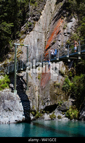 Jumping off the bridge over the Blue Pools, Wanaka New Zealand - Stock Photo