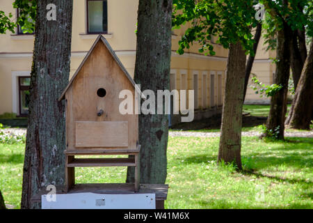Large birdhouse from wooden planks for birds in the park. - Stock Photo