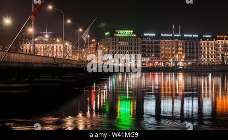 Geneva, Switzerland - November 24, 2016: Street view of Geneva city at night. Pont du Mont-Blanc - Stock Photo