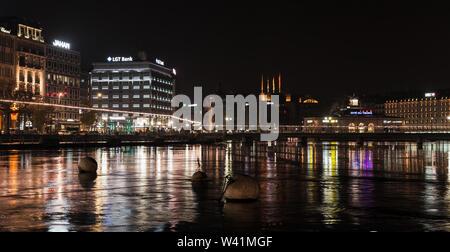 Geneva, Switzerland - November 24, 2016: Panoramic cityscape with illuminated facades of Geneva city central district at night - Stock Photo