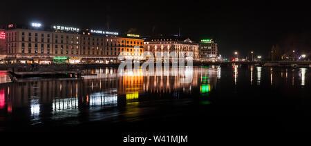 Geneva, Switzerland - November 24, 2016: Night panoramic cityscape with illuminated facades of Geneva city central district - Stock Photo