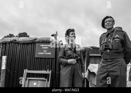 Observer Corps Second World War recreation. Male and female re-enactors in wartime period costume with telephony communications. Monochrome. Blitz ARP - Stock Photo