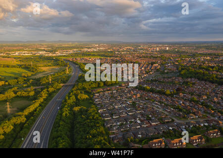 Aerial view above the A19 motorway overlooking the housing estates and countrysid of Stockton-on-Tees in Teeside during sunset on a quiet summers day - Stock Photo