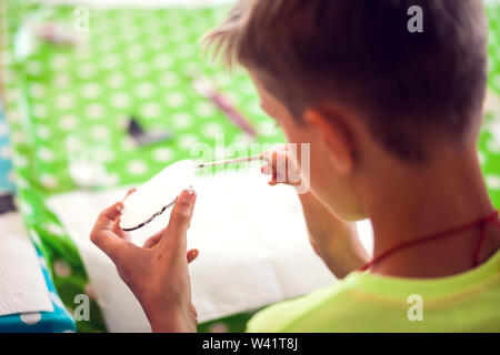 Children hands making artworks with wood and paint crafts. workplace and handcraft Decoupage - Stock Photo