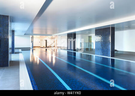 Iamge of a luxurious pool with four swimming tracks - Stock Photo