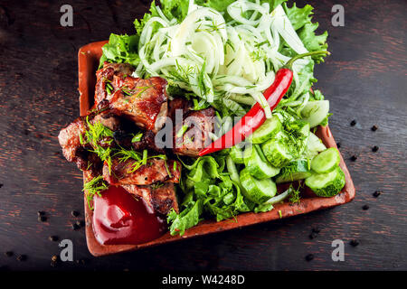 Chopped grilled roasted delicious steak meat lamb pork on a plate - Stock Photo