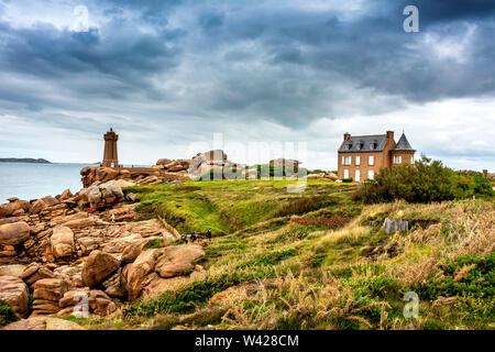Ploumanach Mean Ruz lighthouse in pink granite coast, Perros Guirec, Cotes d'Armor, France - Stock Photo