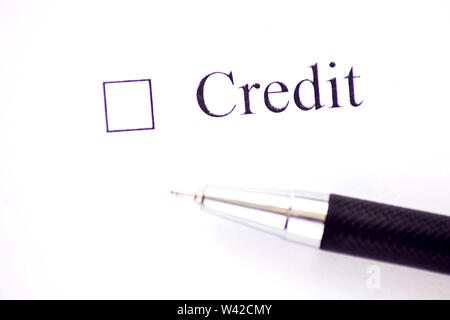 Credit - checkbox with a cross on white paper. Checklist concept. - Stock Photo