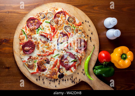 Tasty Pepperoni pizza with salami. Food and cafe concept - Stock Photo