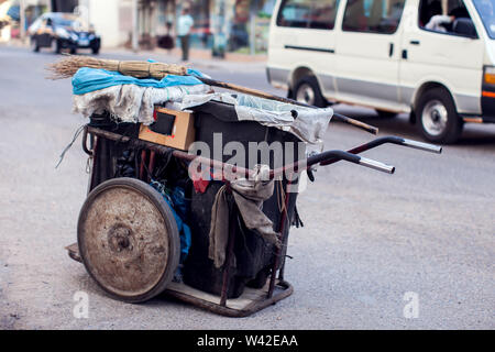 Trash can for cleaning streets on the ground beside road - Stock Photo