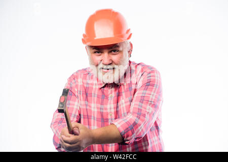 He loves his job. construction build. mature bearded man in hardhat. professional repairman in helmet. man builder use hammer tool. architect repair and fix. engineer worker. - Stock Photo