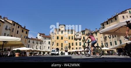 Lucca, Italy - Famous Piazza Anfiteatro in the northeast quadrant of walled center of Lucca - Stock Photo