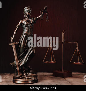 Law offices of lawyers legal statue Greek blind goddess Themis bronze metal statuette figurine with scales of justice. - Image - Stock Photo