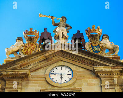 Top of Pamplona Town Hall with clock and blue sky - Stock Photo
