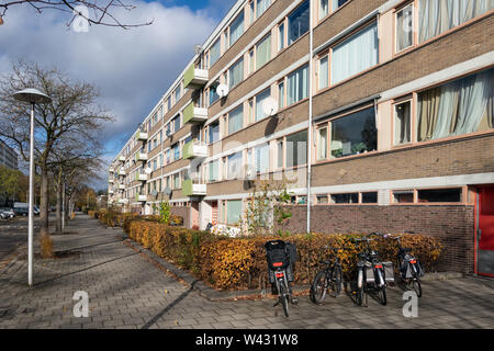 Apartments in residential district Dutch city Utrecht with parked bicycles - Stock Photo