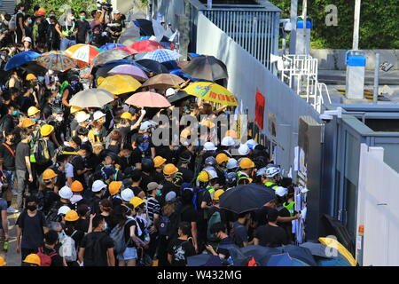 Hong Kong -July 1 2019:  Central Government Offices surround by the protesters. some protester broke the office window in the noon - Stock Photo