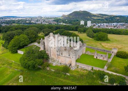Elevated view of Craigmillar Castle and skyline of Edinburgh, Scotland UK.