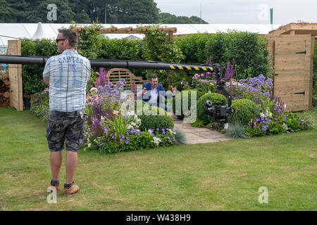Adam Frost doing a piece to camera in the Art and Nature of a Port Sunlight Garden at RHS Tatton Park flower show 2019, Knutsford, Cheshire, England - Stock Photo