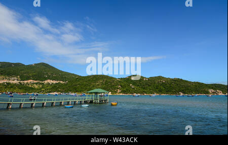 Small jetty for tourists in Nha Trang, Vietnam. Nha Trang is a coastal city and capital of Khanh Hoa, on the South Central Coast of Vietnam. - Stock Photo