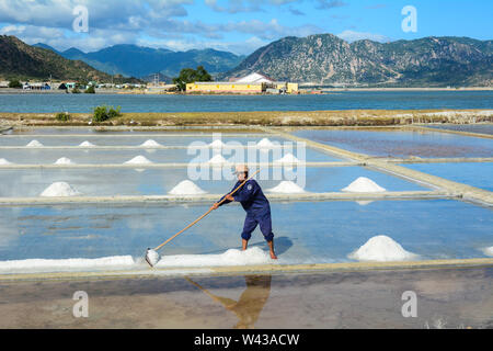 Nha Trang, Vietnam - Jan 27, 2016. A man working on salt field in Nha Trang, Vietnam. Nha Trang is a coastal city and capital of Khanh Hoa, on the Sou - Stock Photo