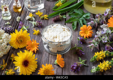 Homemade skin cream made from shea butter, medicinal herbs and essential oils - Stock Photo