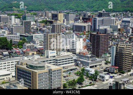 Yamagata, Japan - May 19, 2017. Many tall buildings located at downtown in Yamagata, Japan. Yamagata Prefecture has, since long ago, been an important - Stock Photo