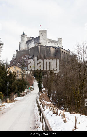 A mid winter view of Hohensalzburg Fortress, Salzburg, Austria.  The fortress sits atop the Festungsberg a small hill. - Stock Photo