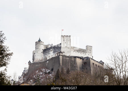 A close up mid winter view of Hohensalzburg Fortress, Salzburg, Austria.  The fortress sits atop the Festungsberg a small hill. - Stock Photo