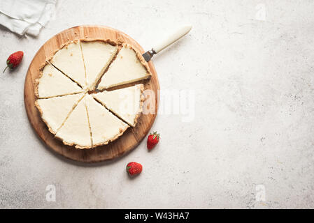Classic Cheesecake. Cheesecake New York on white background, top view, copy space. - Stock Photo